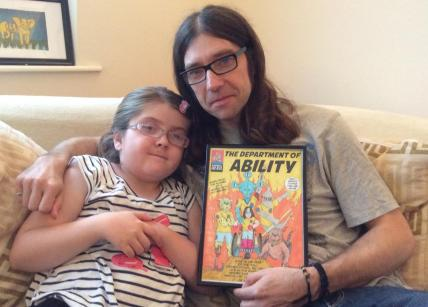 Dan & Emily White, with a preliminary proof of their comic book.