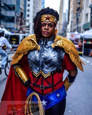 Gina C. - To me, Wonder Woman means, to always being able to show great force and wonderment while still staying beautiful.