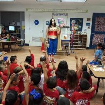 Virginia D. - While I love to attend Comic Cons and such in costume, my favorite is dressing up as Wonder Woman and doing my charity work which includes reading at public schools and libraries as well as visit sick children. To me WW isn't just about physical strength but inner strength such as being fair and just even when others treat her less.